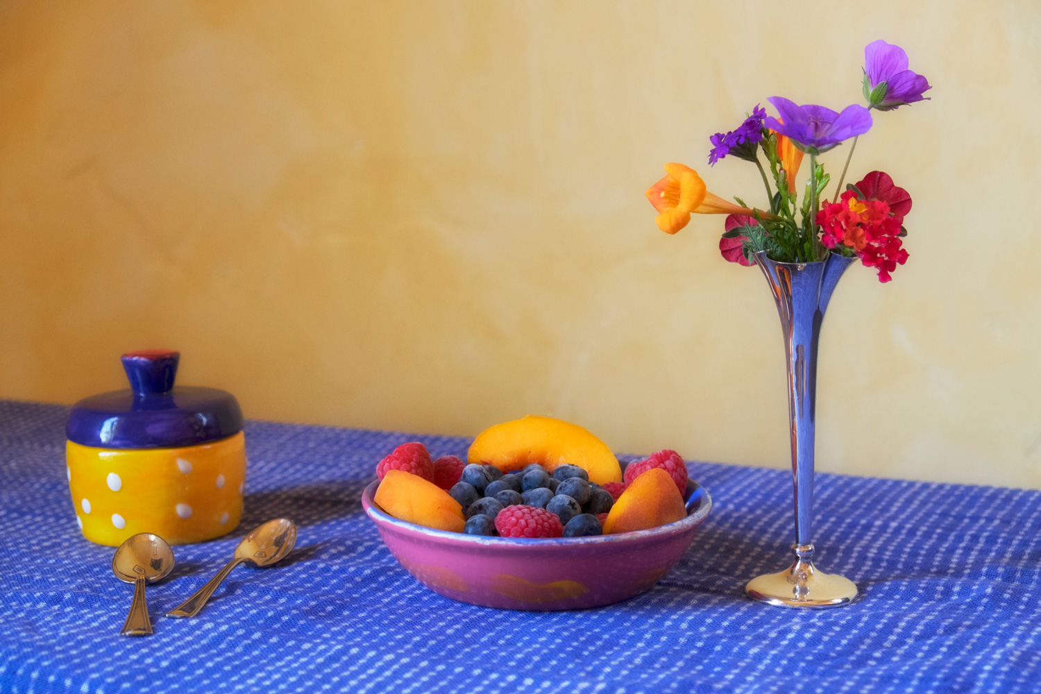 Colorful Fruit and flowers on a table
